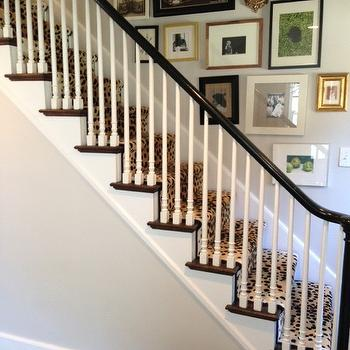 Erin Gates Design - entrances/foyers - stair runner, cheetah stair runner, glenn eden carpets, staircase wall art gallery, art gallery on staircase wall, foyer, black and white staircase,