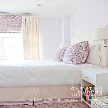 Christina Murphy Interiors - bedrooms - white walls, white bedding, white bed linens, white sheets, pink gray and white floral pillows, floral print pillow, floral print shade, white nightstand, polished nickel wall sconce, adjustable wall sconce, polished nickel swing arm wall sconce, ivory bed skirt with mauve border, pleated bed skirt, ivory drapes, ivory curtains, upholstered headboard, ivory upholstered headboard, pale lavender wall color, lavender wall color,