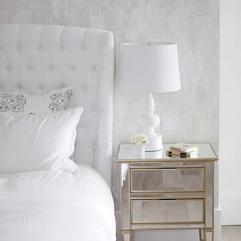 The Cross Decor & Design - bedrooms - white bedroom, white bedroom ideas, white bedroom design, white master bedroom, wallpaper accent wall, white headboard, white tufted headboard, white wingback headboard, tufted wingback headboard, mirrored nightstands, white lamps, white table lamps, white and gray pillows,
