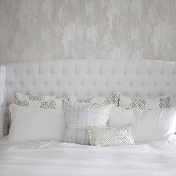 The Cross Decor & Design - bedrooms - white bedroom, white bedroom ideas, white bedroom design, white master bedroom, wallpaper accent wall, white headboard, white tufted headboard, white wingback headboard, tufted wingback headboard, mirrored nightstands, white lamps, white table lamps, white and gray pillows, metallic pillow,