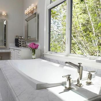 Fautt Homes - bathrooms: his and her vanities, vanities flanking bathtub, beveled mirrors, white vanities, carrera marble, carrera marble countertop, marble tub surround, floating vanity, floating make up vanity, floating marble vanity, metal stool, master bathroom,