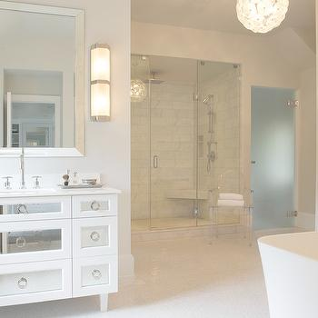 Susan Glick Interiors - bathrooms - mirrored vanity, mirrored bathroom vanity, mirrored washstand, white mirror washstand, white mirrored washstand, white mirror vanity, white mirrored bathroom vanity, mirrored cabinets, mirrored bathroom cabinets, beveled mirror, silver beveled mirror, ring pulls, nickel ring pulls, gooseneck faucet, mini marble tiles, mini marble floor tiles, white mini marble tiles, frosted glass water closet door, water closet with frosted glass door, walk in shower, corner shower bench,