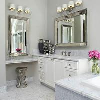 Fautt Homes - bathrooms - his and her vanities, vanities flanking bathtub, beveled mirrors, white vanities, carrera marble, carrera marble countertop, marble tub surround, floating vanity, floating make up vanity, floating marble vanity, metal stool, master bathroom, gray walls, gray bathroom walls,