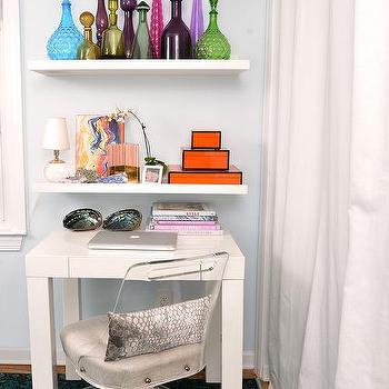 Dalliance Design - dens/libraries/offices - Parsons desk, lacquered box, lucite, lucite chair, brass, overdye rug, overdye, glass bottles, colorful, metallic, white desk, shelves, floating shelves,