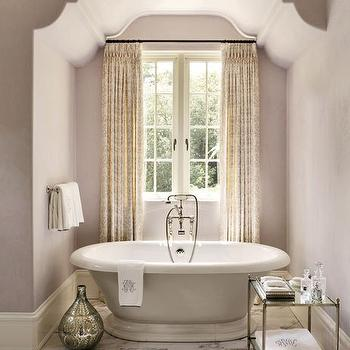 Architectural Digest - bathrooms - Benjamin Moore - Violet Pearl - purple walls, purple wall color, purple bathroom walls, marble tiled floors, marble floor tile, nickel and glass etagere, etched silver vase, freestanding tub, freestanding bath, floor mounted faucet, cream and lavender pattered drapes, cream and lavender patterned curtains, tub under window, bath under window, polished nickel towel rail, monogrammed towels, window nook, bathroom nook, , bathtub alcove, tub alcove, alcove bathtub, bathtub in alcove,