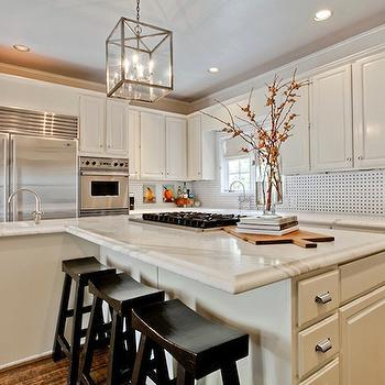 Underwood Interiors - kitchens - off white cabinets, off white kitchen cabinets, calcutta gold marble, calcutta gold marble counters, calcutta gold marble countertops, black and white backsplash, off white kitchen island, sawhorse stools. glass and nickel lantern,