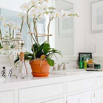 Ally Coulter Designs - bathrooms - white bathroom, inset cabinets, inset bathroom cabinets, white bathroom cabinets, white countertops, subway tiled countertops, framed mirror, framed bathroom mirror, white framed mirror, bathroom orchid,