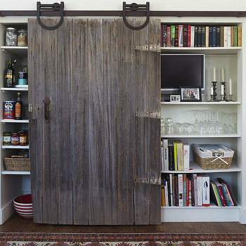 Yankee Magazine - kitchens - sliding barn door, barn door, rustic barn door, kitchen barn door, sliding pantry barn door, pantry shelves, kitchen tv, kitchen television, cookbooks, cookbook storage, hardwood floors, white walls, interior barn door, pantry with barn door, barn door pantry,