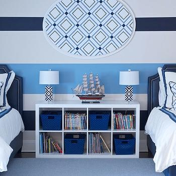 Morgan Harrison Home - boy's rooms - shared kids room, shared boys room, shared boys bedroom, striped walls, striped accent wall, white and blue striped wall, horizontal striped walls, blue headboards, boys headboards, twin blue headboard, blue twin headboard, blue bed skirt, boys bed skirt, white and blue bedding, white and blue pillows, geometric pillows, shared nightstand, bookcase as nightstand, expedit shelving unit, expedit bookcase, ikea bookcase, white and blue lamps, white and navy blue lamps, geometric lamps, white and blue boys room, white and blue boys bedroom, Ikea Expedit Shelving Unit,