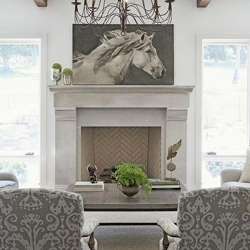 Rachel Halvorson Design - living rooms - chic living room, herringbone firebox, stone fireplace, large fireplace, tall fireplace, horse art, horse canvas art, reclaimed wood coffee table, ikat chairs, ikat armchairs, gray ikat chairs, wood beams, living room beams, living room wood beams,