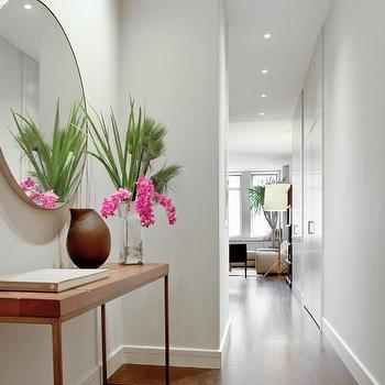 Wettling Architects - entrances/foyers - recessed lighting, pot lights, hardwood floors, gray walls, gray wall color, contemporary console table, iron and wood console table, contemporary iron and wood console table, brown vase, tropical flowers, round mirror, round floating frame mirror, round chrome framed mirror, foyer mirror, foyer, round foyer mirror, large foyer mirror,