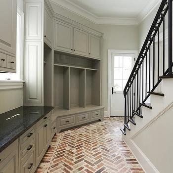 HAR - laundry/mud rooms - angled mudroom, mudroom, mudroom ideas, mudroom design, mud room ideas, gray cabinets, gray cabinets with black countertops, mudroom cabinets, open lockers, mudroom lockers, mudroom open lockers, mud room lockers, beadboard trim, brick floor, brick herringbone floor,