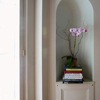 Andrew Maier - entrances/foyers - arched niche, niche, hallway niche,  Hallway with arched niche housing books and pink orchid.