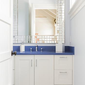 Jill Litner Kaplan Interiors - bathrooms - blue and white bathroom, white vanity, white built-in vanity, brushed nickel hardware, blue counter, blue counters, blue countertop, blue countertops, modern faucet, white lacquered soap dispenser, white lacquered tissue box cover, mosaic mirror framed mirror, mirrored mosaic mirror,