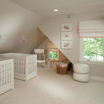 Tiffany Farha Design - nurseries - gray walls, gray wall color, pink and gray nursery, girl nursery, twins nursery, pink and gray twins nursery, white crib, modern white crib, pink and white crib bedding, butterfly mobile, pink and gray butterflies mobile, butterflies mobile, eaves, painted gray ceiling, recessed lighting, pot lights, rocking chair, white rocking chair, gray pillow, rattan basket, woven rattan basket, white roman shade with pink trim, white roman shade with pink grosgrain trim, toys, gray carpet, light gray carpet, wall to wall carpet, modern white side table, white moroccan pouf, moroccan leather pouf, white moroccan leather pouf, West Elm White Martini Side Table, pink and gray nursery, nursery for twins,