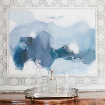 Collins Interiors - dining rooms - abstract art, blue abstract art, geometric wallpaper, blue and gray wallpaper, blue and gray geometric wallpaper, sideboard, dining room sideboard, antique sideboard, chair rail, dining room chair rail, Phillip Jeffries Imperial Gates Wallpaper,