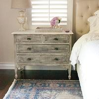 Chic bedroom with tan walls framing tan tufted headboard accented with white ...