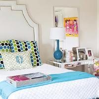 B Metro - girl's rooms - nailhead headboard, studded headboard, white studded headboard, white headboard with nailhead trim, dots pillows, mirrored desk, mirrored vanity, desk as nightstand, blue lamp, blue table lamp, ghost chair, turquoise throw, turquoise blue throw, faux croc tray, silver faux croc tray,