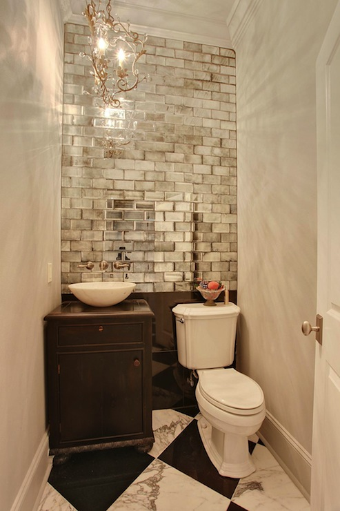 Troyer Builders - bathrooms - powder room, small powder room, mirrored subway tiles, accent wall, powder room accent wall, ceiling height tiles, ceiling height bathroom tiles, powder room chandelier, distressed washstand, bowl sink, white bowl sink, wall mounted faucet, checkered floor, black and white tiles, black and white floor.,