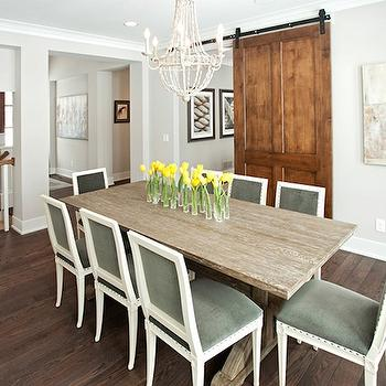 Studio M Interiors - dining rooms - velvet dining chairs, green dining chairs, green velvet dining chairs, trestle dining table, limed oak dining table, beaded chandelier, white beaded chandelier, interior barn door, dining room barn door,