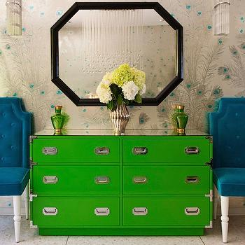 Redbook Magazine - entrances/foyers - hollywood regency decor, hollywood regency foyer, campaign dresser, green campaign dresser, kelly green dresser, malachite accents, hollywood regency chairs, turquoise chairs, turquoise velvet chairs, turquoise tufted chairs, peacock feathers wallpaper, metallic wallpaper, silver and turquoise wallpaper,