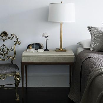 Brendan Wong Design - bedrooms: bed with no headboard, gray blanket, gray silk blanket, gray sham, gray velvet sham, , herringbone blanket, gray herringbone blanket, purple pillow, gray and purple bedding, antique brass lamp, gold chair, french chair, gold french chair,