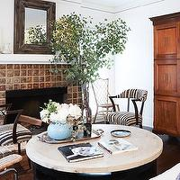 Domaine Home - living rooms - celebrity home, fireplace seating, fireplace chairs, striped chairs, black and white chairs, black and white striped chairs, marble top coffee table, round coffee table, round marble top coffee table, armoire, living room armoire,