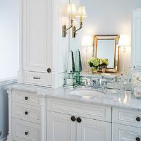 Kimberley Seldon Design Group - bathrooms - bathroom accents, mirrored obelisk, white vanity, carrera marble top, carrera marble countertop, glass canisters, bathroom canisters, vintage perfume bottles,