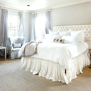 Cote de Texas - bedrooms - ornate gold mirror, ornate gilt mirror, faux snakeskin side table, recessed lighting, pot lights, sisal carpet, wall to wall sisal carpet, gray walls, gray wall color, tufted headboard, ivory tufted headboard, white bedding, white bed linens, white sheets, bed skirt, black and gold side table, black and gold nightstand, round black and gold nightstand, ruffled bed skirt, gray slipcovered wing chair, gray slipcovered wingchair, gray side table, gray taffeta curtains, gray taffeta drapes, floor length, drapes, floor length curtains, white gourd lamp, gray pillow, gray throw, crown molding, taffeta drapes, taffeta curtains, gray silk curtains, gray silk drapes,