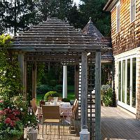 Bella Mancini Design - decks/patios - deck, cedar shingles, cedar shingle siding, pergola, deck pergola, contemporary outdoor dining set, contemporary outdoor dining table, glass patio door, white outdoor lantern, outdoor lantern, pergola, pergola ideas,