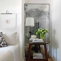 Gorgeous bedroom with white walls and light hardwood floors. The bedroom features ...