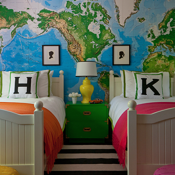 Grant K. Gibson - boy's rooms - map wallpaper, world map wallpaper, world map mural, white bed, twin beds, pair of beds, white bedding with green border, green and white bedding, green and white bed linens, black and white striped rug, yellow moroccan pouf, pink moroccan pouf, moroccan pouf, initialed pillow, green and white pillow with black initial, campaign nightstand, green campaign nightstand, green nightstand with brass hardware, ginger jar lamp, yellow ginger jar lamp, unisex bedroom, gender neutral bedroom, orange throw, pink throw, framed silhouette, silhouette, striped rug, green campaign chest, campaign chest, Toys R Us World Map Wall Mural,