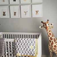 Grant K. Gibson - nurseries - gray walls, gray wall color, hardwood floors, dark hardwood floors, giraffe toy, baby animal art, framed baby animal art, white crib, modern white crib, gray and yellow crib bedding, gray and white polka dot crib bedding, yellow and white striped crib bedding, Sharon Montrose The Animal Print Shop, Melissa & Doug Plush Giraffe, nursery art ideas, nursery art, yellow and gray crib bedding, The Animal Print Shop, Melissa & Doug Plush Giraffe,