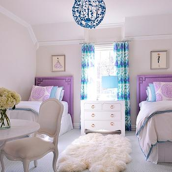 Tracy Hardenburg Designs - girl's rooms - shared girls room, shared girls bedroom, shared kids room shared kids bedroom, indigo blue chandelier, kids chandeliers, girls chandelier, ikat curtains, ikat drapes, turquoise and purple curtains, turquoise and purple drapes, greek key headboards, greek key trim, purple headboards, twin headboards, kids headboards, girls headboards, twin purple headboard, bungalow 5 nightstand, shared nightstand, turquoise pillows, turquoise lamp shade, faux bois table, vintage fashion prints, Jacqui 4-Drawer Table, Kazak Aqua Lilac on White, Stray Dog Designs Celeste Sphere, Global Views Faux Bois Table,