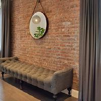 Spruce Interior Design - living rooms - exposed brick wall, captains mirror, leather captains mirror, hanging captains mirror, hanging leather mirror, leather hanging mirror, linen bench, tufted bench, gray bench, gray linen bench, gray tufted bench, gray linen tufted bench, wide plank floor, gray curtains, gray drapes, floor to ceiling curtains,