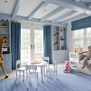 Lauren Stern Design - boy's rooms - boys room, boys bedroom, blue boys room, blue boys room, blue boys bedroom, blue bookcase, built ins, built in cabinets, blue built ins, blue built in cabinets, kids built ins, kids built in cabinets, blue curtains, blue drapes, blue wood beams, daybed, linen daybed, boys daybed, kids daybed, indigo blue throw, play table and chairs, blue rug, kids room rug, kids rug, blue roman shades, Melissa & Doug Plush Giraffe,
