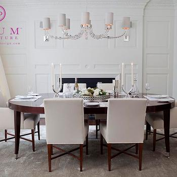 McGill Design Group - dining rooms - fireplace, dining room fireplace, paneled dining room, oval dining table, lacquered dining table, upholstered dining chairs, gray rug, www.mcgilldesign.ca, Plum Furniture, Plum, www.myplumdesign.com, Colleen McGill, McGill Design Group, Toronto,