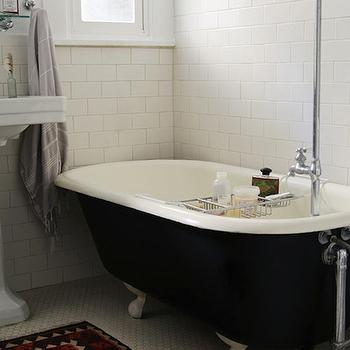 Design Sponge - bathrooms - pedestal sink, towel hook, gray towel, white subway tile, subway tile, subway tiled bathroom, marble hex floor tile, marble hex tiled floor, claw foot tub, black claw foot tub, floor mounted faucet, floor mount faucet, kilim rug, bath rack, bath tray, hexagonal marble floor tile, claw foot bath, clawfoot tub, black clawfoot tub,