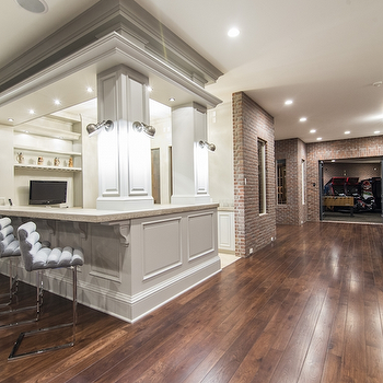 basements: basement living room, basement family room, family room, game room, basement game room, basement bar, basement wet bar, gray wet bar, gray bar stools, video game room, gray velvet bar stool,