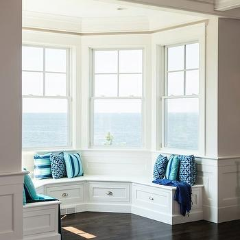 Lewis and Weldon - living rooms - builtin window seat, window seat, curved window seat, window seat with storage, blue pillows, turquoise pillows, ocean view, reading nook,