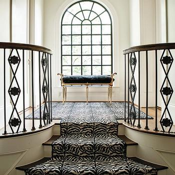 Atlanta Homes & Lifestyles - entrances/foyers - entry, foyer, black and white foyer, black and white entry, stair runner, zebra stair runner, black and white zebra stair runner, palladian window, arched window, steel and glass window, french bench, black bench, black french bench,