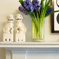 Matchbook Magazine - living rooms - white fireplace, fireplace, fireplace vignette, flowers, vase of flowers, vase of hyacinths, blue hyacinths, foo dogs, white foo dogs, fireplace mantle,