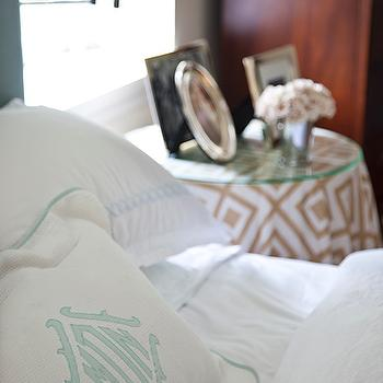 Mona Ross Berman Interiors - bedrooms - skirted bedside table, glass top bedside table, david hicks la fiorentina, la fiorentina, round skirted table, round skirted bedside table, seafoam green headboard, white and blue bedding, monogrammed shams,
