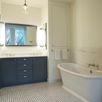 Elizabeth Roberts Design - bathrooms - freestanding tub, freestanding bath, basketweave floors, basketweave tiled floors, basketweave marble tile floors, basketweave marble tiled floors, marble backsplash, marble tub backsplash, marble bath backsplash, seamless marble backsplash, seamless tub backsplash, charcoal gray bathroom vanity, built-in vanity, built-in dual vanity, marble counter, marble countertop, framed vanity mirror, globe glass pendant, spherical glass pendant, dual vanity, his and hers sink, wall mounted faucet, wall mount faucet, nickel towel rail, white towels, dark gray vanity, dark gray bathroom vanity, dark gray bathroom cabinets,