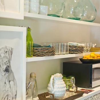 HGTV - kitchens - Sherwin Williams - Eider White - butlers pantry, butler's pantry, gray walls, gray wall color, black and white dog art, dog art, framed dog art, black and white framed dog art, gray and white geometric skirted cabinets, skirted cabinetry, geometric skirted cabinets, pleated skirted cabinets, green glasses, green bottles, woven trays, bowls, demijohn, demi john, floating shelves, pantry shelving, butler's pantry shelving, white floating shelves, Windsor Smith Pelagos Fabric, butlers pantry shelves,