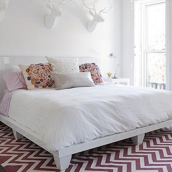 The Brooklyn Home Company - bedrooms - purple and white zig zag rug, purple and white chevron rug, chevron rug, zig zag rug, white lacquered bed, modern white lacquered bed, white bedding, lilac bedding, multi-colored pillow, white sheets, white bed linens, gray pillow, mirrored mosaic pillow, white parsons nightstand, white parsons end table, parsons end table, matching end tables, hardwood floors, dark hardwood floors, nickel adjustable desk lamp, adjustable desk lamp, white walls, white wall color, faux taxidermy, faux taxidermy over headboard, faux taxidermy over bed, deer faux taxidermy, white deer faux taxidermy, lacquered headboard, chevron rug, purple chevron rug, West Elm Parsons End Table,