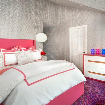 Suzanne Lovell - girl's rooms - gray wallpaper, gray and white geometric wallpaper, geometric wallpaper, multi-colored carpet, wall to wall carpet, multi-colored dot carpet, woven pouf, pink woven pouf, turquoise woven pouf, pink bed, pink headboard, pink felt headboard, pink headboard with blue piping, modern white nightstand, modern white round nightstand, matching nightstand, white round pendant, hotel bedding, pink hotel bedding, pink and white hotel bedding, gray fluffy pillow, pink and white dresser, pink dresser with white drawer fronts, modern pink and white dresser, gummy bear lamp, gummy bear table lamp, vaulted ceiling, wallpapered ceiling, pink bed, pink upholstered bed,