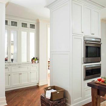 TerraCotta Properties - kitchens - diagonal floor, diagonal wood floors, floors laid out diagonally, ceiling height cabinets, mirrored doors, mirrored cabinet doors, white and gray granite, white and gray granite ocuntertops,