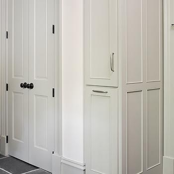 Tillman Long Interiors - laundry/mud rooms - laundry room, laundry room cabinets, gray cabinets, pull out cabinets, charcoal gray tiles, charcoal gray tile floor, mudroom, mudroom cabinets,