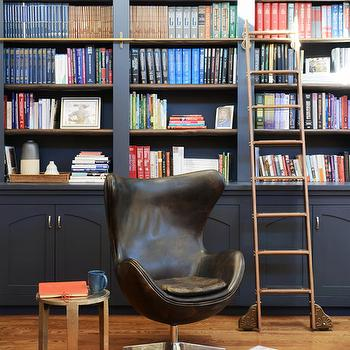 Ore Studios - dens/libraries/offices - arched bookcase, arched bookshelf, built in bookcase, built in bookshelf, navy blue bookcase, navy blue bookshelf, bookcase ladder, bookshelf ladder, vintage library ladder, library ladder, navy blue built ins, navy bookshelf, navy bookcase, vintage chair, vintage leather chair, black leather chair, antique brass table,